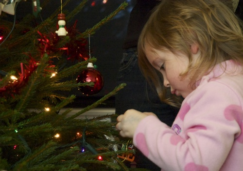 Annabel decorating the Christmas tree