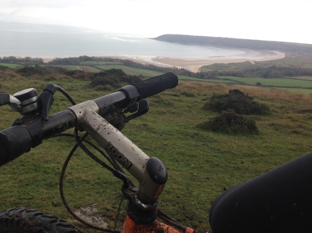 Mountain biking with views of Oxwich Bay.